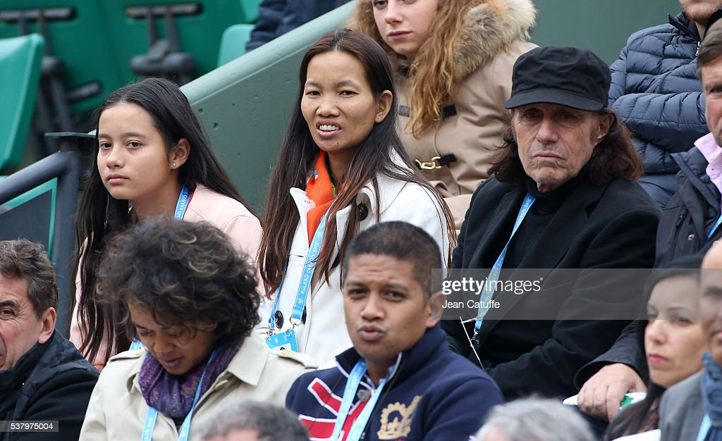 <a gi-track='captionPersonalityLinkClicked' href=/galleries/search?phrase=Guillermo+Vilas&family=editorial&specificpeople=605489 ng-click='$event.stopPropagation()'>Guillermo Vilas</a>, his wife Phiangphathu Khumueang and their daughter Andanin Vilas attend day 13 of the 2016 French Open held at Roland-Garros stadium on June 3, 2016 in Paris, France.