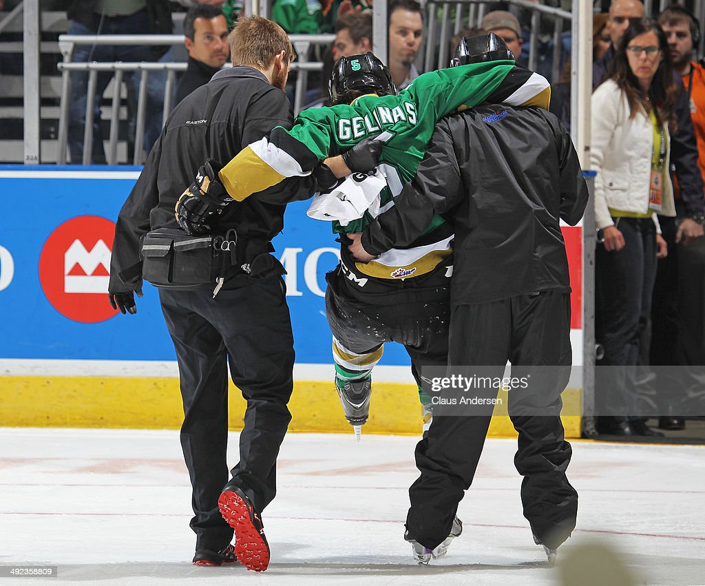 Guilllaume Gelinas #5 of the Val'Dor Foreurs is carried off the ice against the Guelph Storm in Game Four of the 2014 MasterCard Memorial Cup at Budweiser Gardens on May 19, 2014 in London, Ontario, Canada. The Storm defeated the Foreurs 6-3.