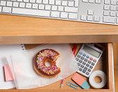 Guilty doughnut hidden in desk drawer