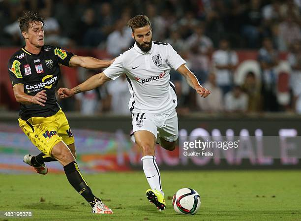 Guimaraes midfielder Alex with Altach's Boris Prokopic in action during the UEFA Europa League Qualifier between Guimaraes and Altach at Estadio D...