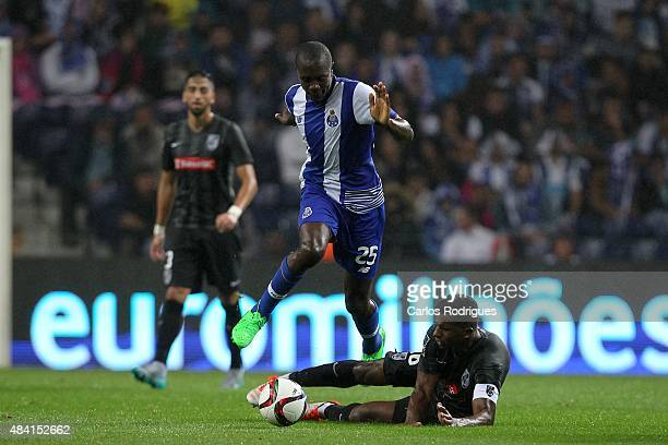 Guimaraes's forward Cafu tackles Porto's midfielder Giannelli Imbula during the match between FC Porto and Vitoria Guimaraes for the Portuguese...