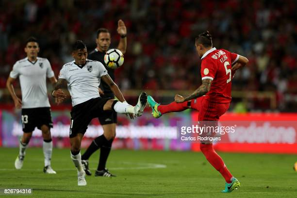 Guimaraes's forward Paolo Hurtado from Peru vies with Benfica's midfielder Ljubomir Fejsa from Serbia during the match between SL Benfica and VSC...