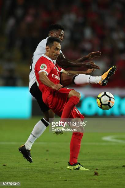 Guimaraes's midfielder Bongani Zungu from South Africa vies with Benfica's forward Jonas from Brasil during the match between SL Benfica and VSC...