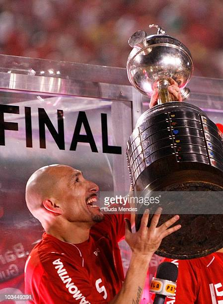 Guinazu of Internacional celebrates championship title after defeating Chivas during a final match as part of the 2010 Copa Santander Libertadores at...