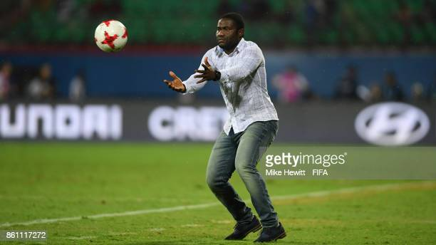 Guinea coach Souleymane Camara catches the ball during the FIFA U17 World Cup India 2017 group C match between Guinea and Germany at Jawaharlal Nehru...
