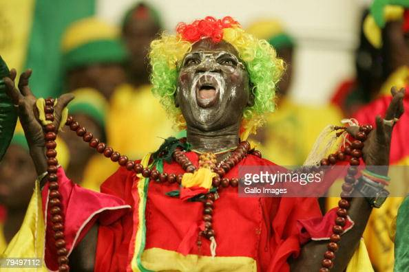 Guinea fan celebrates during the quater final AFCON match between Ivory Coast and Guinea held February 3 2008 at the Sekondi Stadium in...