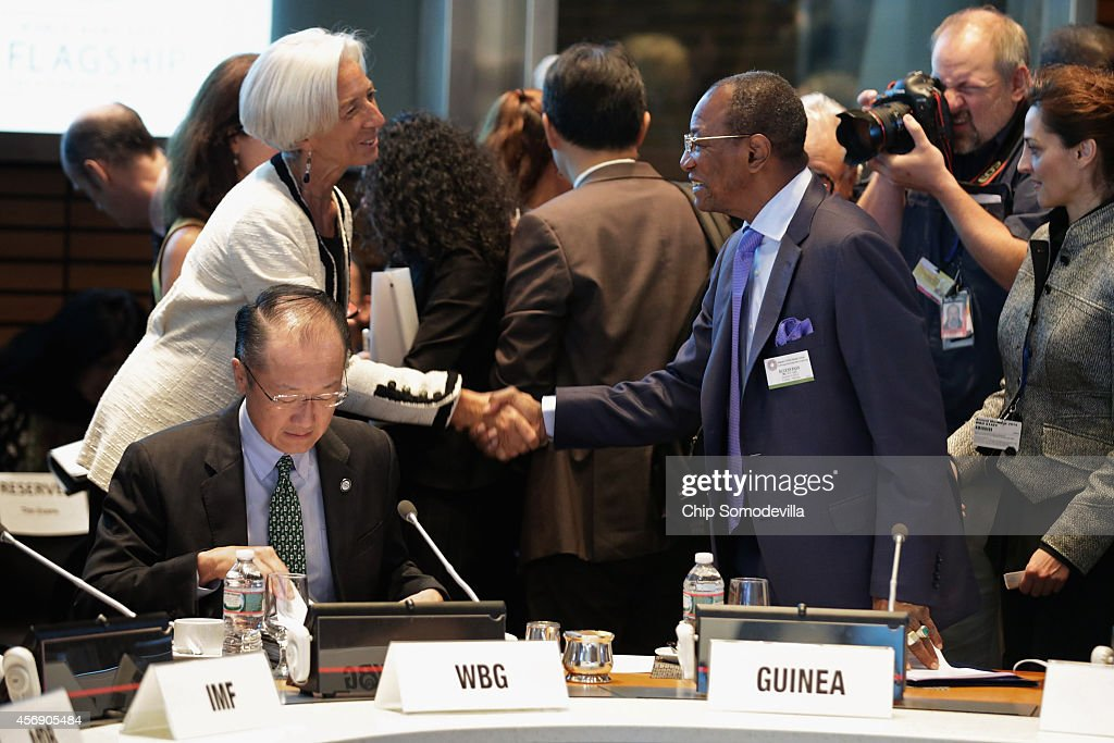 Guinea President Alpha Conde (R) greets International Monetary Fund Managing Director Christine Lagarde (L) with World Bank Group President Jim Yong Kim before a meeting on the Ebola crisis during the International Monetary Fund-World Bank Group annual meetings October 9, 2014 in Washington, DC. Sierra Leone President Bai Koroma and Liberia President Ellen Johnson Sirleaf joined the conference via video link.