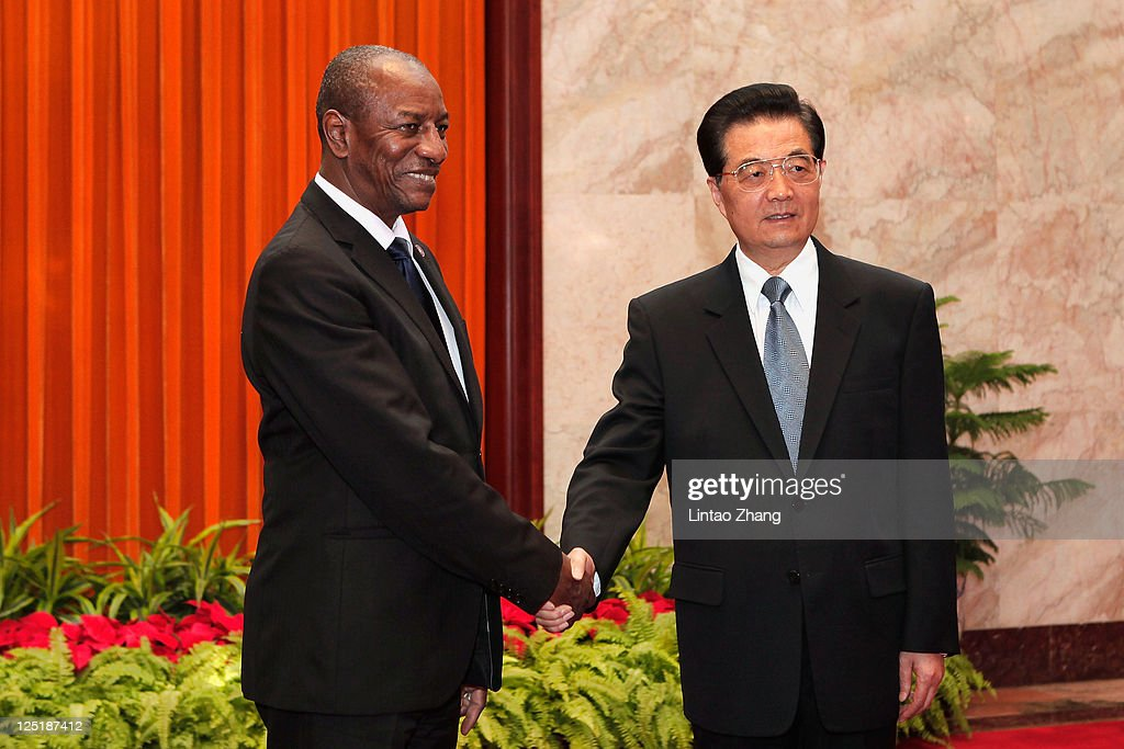Guinea President Alpha Conde (L) shakes hands with Chinese President <a gi-track='captionPersonalityLinkClicked' href=/galleries/search?phrase=Hu+Jintao&family=editorial&specificpeople=203109 ng-click='$event.stopPropagation()'>Hu Jintao</a> at the Great Hall of People on September 16, 2011 in Beijing, China. President Conde attended the World Economic Forum 'Summer Davos' China Meeting in Dalian, Liaoning province two days ago.