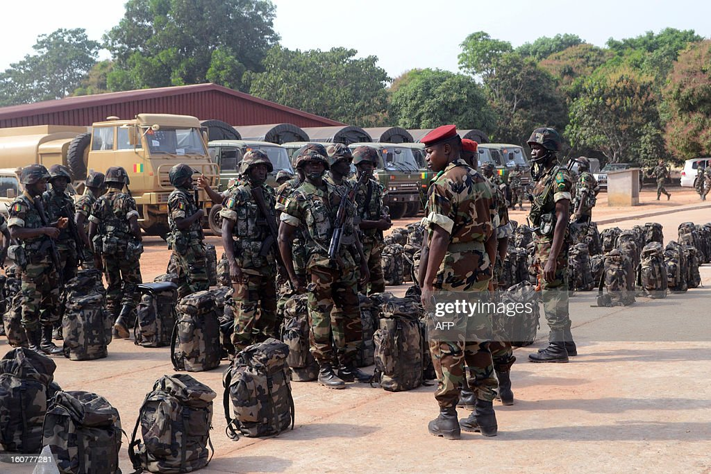 Guinea troops parade on February 5, 2013 before their departure for Mali at the military base at Kindia.