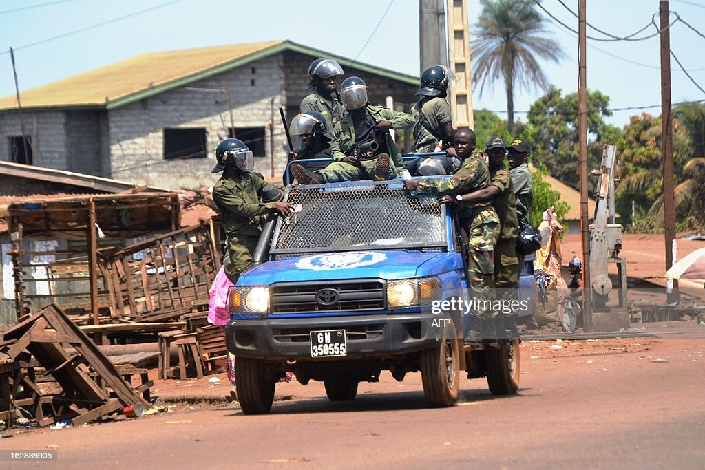Guinean gendarmes patrol on February 28, 2013 in Conakry, where violence broke out on February 27 during a Guinean opposition demonstration. Some 130 people were wounded, including 68 police, on February 28 in the latest in a string of opposition demonstrations to demand transparency in elections scheduled for May 12 and protest against the South African company selected to revise the electoral roll. AFP PHOTO / CELLOU BINANI