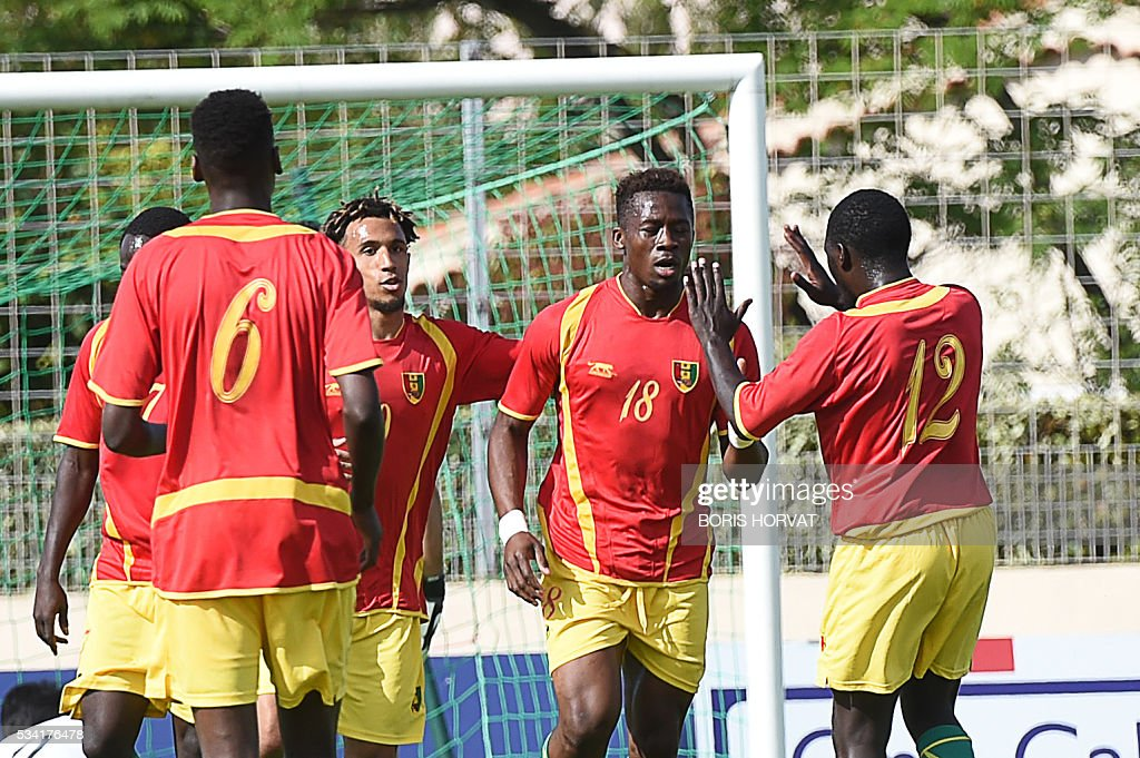 Guinean players celebrate after scoring, during the Under 21 international football match between Japon and Guinea, at the Antoine Baptiste stadium in Six-Fours, southern France on May 25, 2016, as part of the Tournoi Espoirs de Toulon (Toulon Hopefuls' Tournament). / AFP / BORIS
