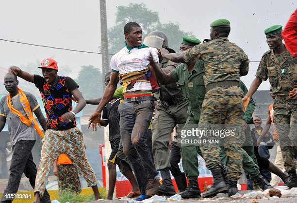 Guinean policemen arrest supporters of Guinea's exiled former junta chief Moussa Dadis Camara on August 26 in Conakry A plane carrying Guinea's...