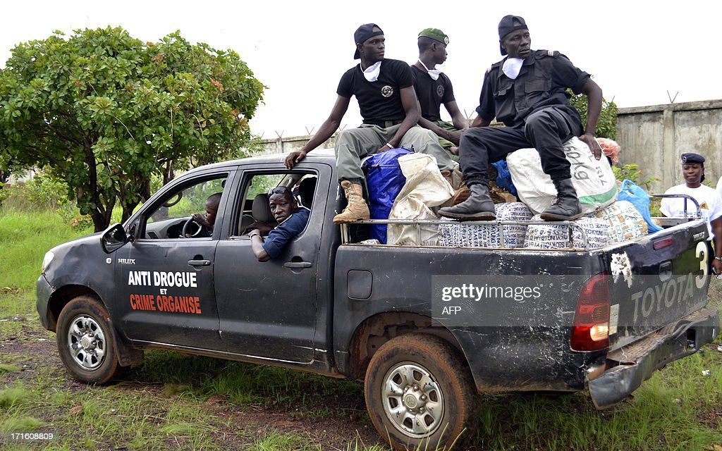 Guinean policemen arrive on June 26, 2013 with packages of seized drugs to be burnt in Conakry during celebrations marking the International Day Against Drug Abuse and Illicit Trafficking.