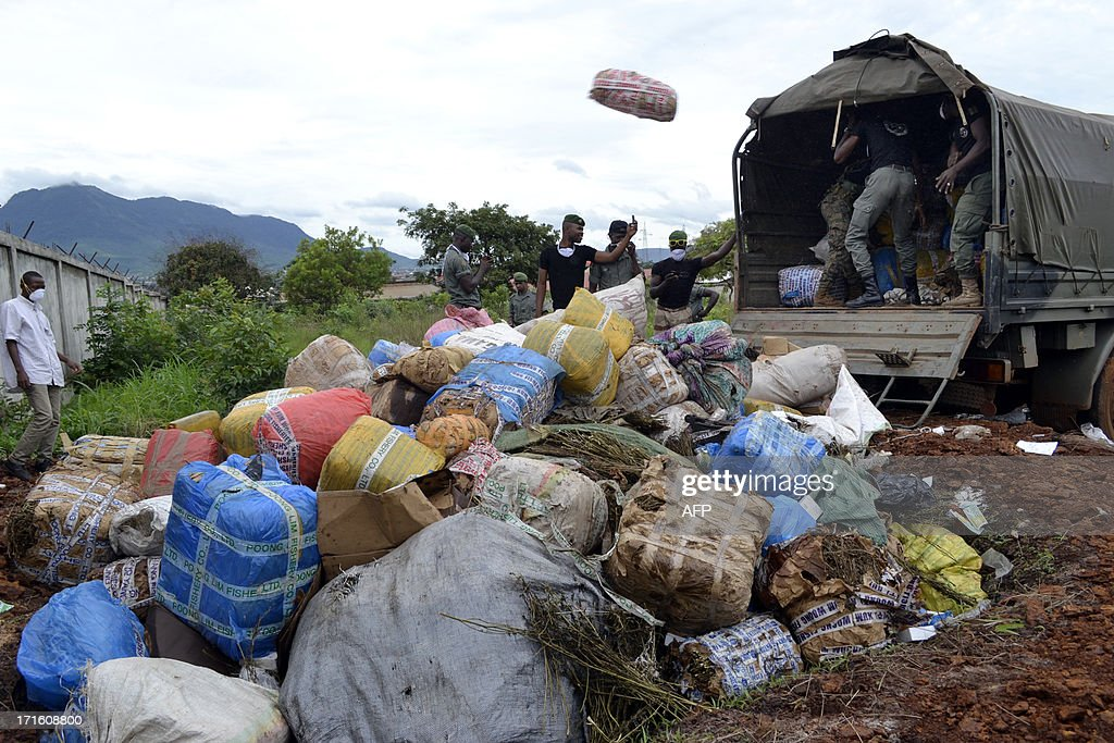 Guinean policemen unload on June 26, 2013 packages of seized drugs to be burnt in Conakry during celebrations marking the International Day Against Drug Abuse and Illicit Trafficking.