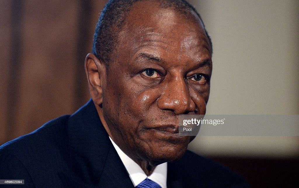 Guinean President Alpha Condé looks on in the Cabinet Room of the White House April 15, 2015 in Washington, D.C. The three Presidents discuss the progress made in the international Ebola response to-date.