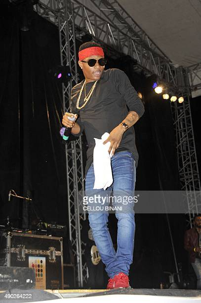 Guinean singer Wizkid perfoms during a concert gathering artists from across Africa to celebrate Guinea reaching the final stages of the battle with...