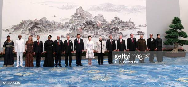Guinea's First Lady Djene Kaba Conde and Guinea's President Alpha Conde Mexican First Lady Angelica Rivera and Mexican President Enrique Pena Nieto...