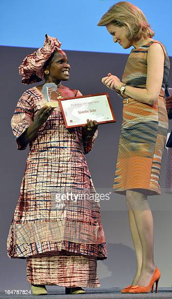 Guinea's Koumba Keita from the Groupement Wakali De Dabola is awarded the Womed Prize South by Belgium's Princess Mathilde late on March 27 in...