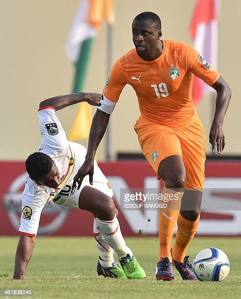 Guinea's midfielder Kevin Constant challenges Ivory Coast's midfielder Yaya Toure during the 2015 African Cup of Nations group D football match...