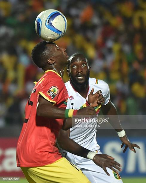 Guinea's midfielder Naby Keita vies with Mali's forward Mustapha Yatabare during the 2015 African Cup of Nations group D football match between...