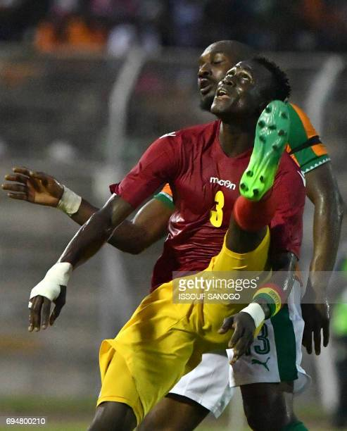 Guinea's national football team player Issiaga Sylla fights fors the ball with Ivory Coast's Sio Giovanni on June 10 2017 during the 2019 African Cup...