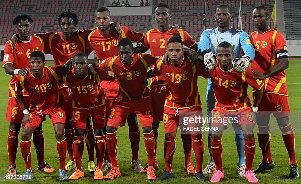 Guinea's players pause before the World Cup 2018 qualifier football match between Guinea and Namibia on November 15 2015 in Casablanca AFP PHOTO /...