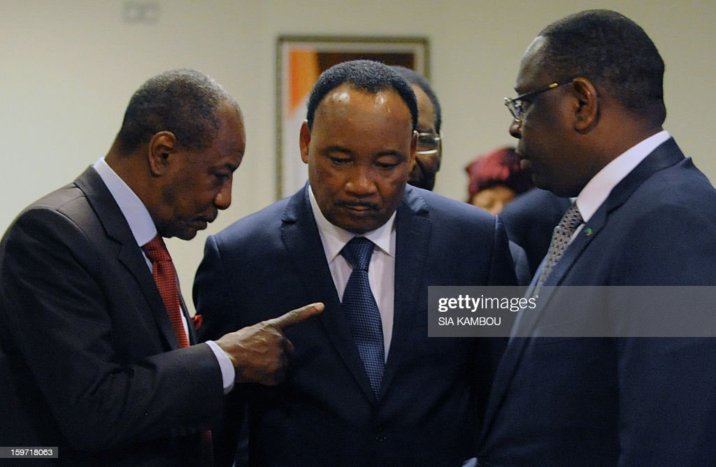 Guinea's President Alpha Conde (L), Niger's President Mahamadou Issoufou (C) and Senegal's President Macky Sall chat during a meeting on the sidelines of the opening session of the regional bloc ECOWAS summit on expediting an African force to come to Mali's aid, on January 19, 2013 in Abidjan. Ivorian President and current head of the regional bloc ECOWAS, Alassane Ouattara today called for a broader international commitment to the military operations in Mali, where Malian and French forces are battling Islamist militant groups that control the country's vast arid north.