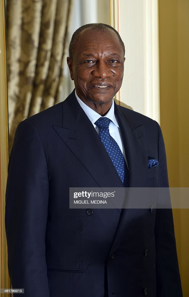 Guinea's president Alpha Conde poses during a visit in Paris on January 19, 2015.