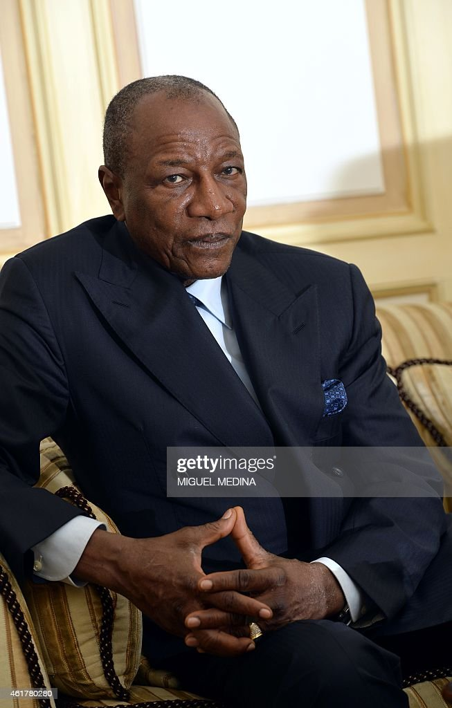 Guinea's president Alpha Conde poses during a visit in Paris on January 19, 2015. AFP PHOTO / MIGUEL MEDINA