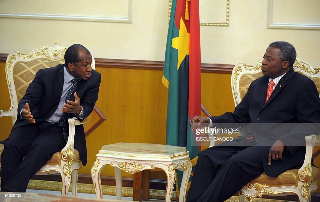 Guinea's Prime Minister, Kabine Komara, talks with his Burkinabe counterpart Tertius Zongo (R) on October 9, 2009 during a meeting in Ouagadougou. African policy makers meet in Ouagadougou today to discuss climate change just two months before a critical UN summit where African countries are poised to seek billions in compensation for the effects of global warming. The foreign minister of the Economic Community of West African States (ECOWAS) are due to meet in Abudja on October 12 to discuss the situation in Guinea, officials in Burkina Faso said Friday. AFP PHOTO/ ISSOUF SANOGO