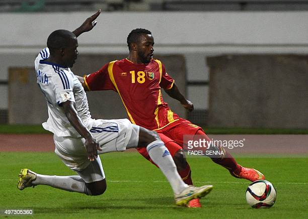 Guinea's Seydouba Soumah fights for he ball with the Namibia's Mwedihanga during the World Cup 2018 qualifier football match between Guinea and...