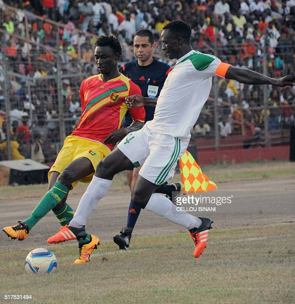 Guinea's Seydouba Soumah vies with Malawi's captain Limbkan Mzava during the 2017 African Cup of Nations qualification football match between Guinea...
