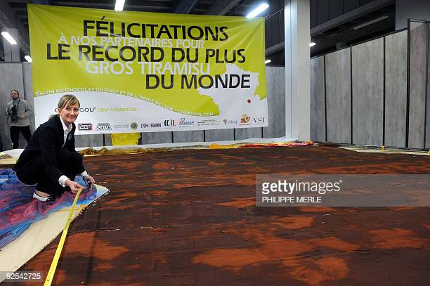 A Guiness World Records judge measures the world biggest tiramisu on October 30 during the third edition of a chocolate and taste fair in...