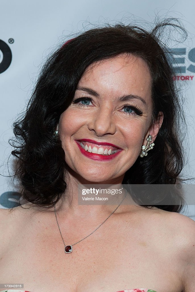 Guinevere Turner attends the 2013 Outfest Opening Night Gala Of 'C.O.G.' - Red Carpet at Orpheum Theatre on July 11, 2013 in Los Angeles, California.