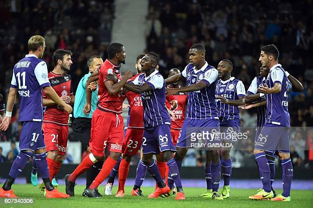 Guingamp and Toulouse's players argue during the French L1 football match Toulouse against Guingamp on September 17 2016 at the Municipal Stadium in...