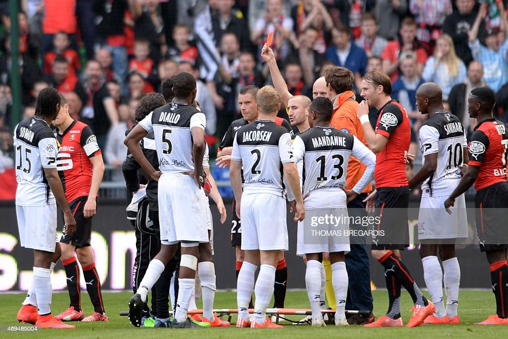 Guingamp' player Sambou Yatabare receive a red card during the French L1 football match between Rennes and Guingamp on April 12, 2015 at the route de Lorient stadium in Rennes, western France.