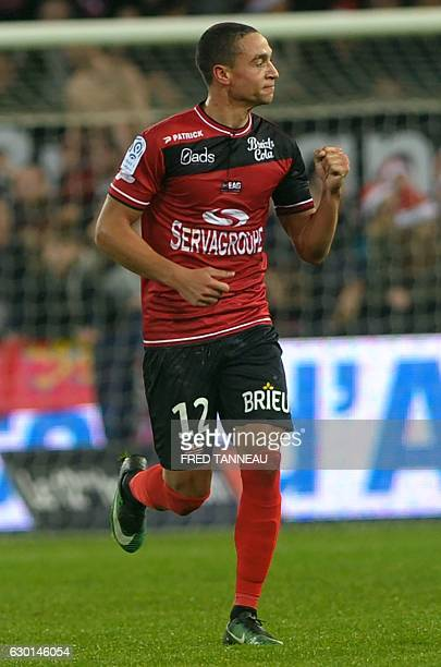 Guingamp's Belgian forward Nill De Pauw celebrates after scoring during the French Ligue 1 football match Guingamp against PSG on December 17 2016 at...