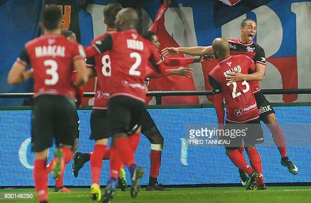 Guingamp's Belgian forward Nill De Pauw is congratulated by his teammates on scoring during the French Ligue 1 football match Guingamp against PSG on...