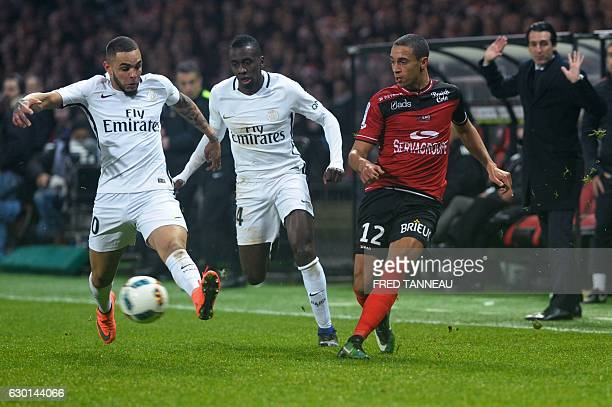 Guingamp's Belgian forward Nill De Pauw vies with Paris SaintGermain's French defender Layvin Kurzawa and Paris SaintGermain's French midfielder...