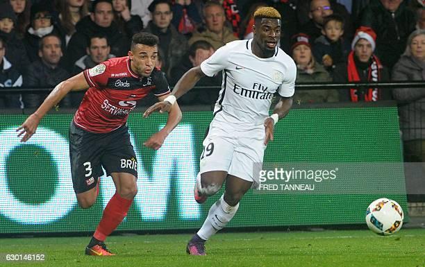 Guingamp's Brazilian defender Fernando Marcal de Oliveira vies with Paris SaintGermain's Ivorian defender Serge Aurier during the French Ligue 1...