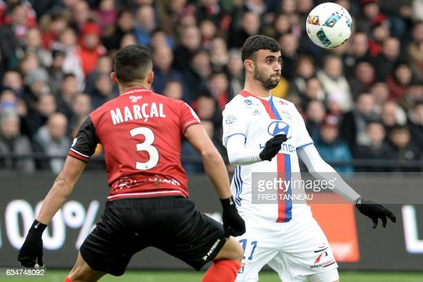 Guingamp's Brazilian defender Fernando Marcal de Oliveira vies with Lyon's French Algerian midfielder Rachid Ghezzal during the French Ligue 1...