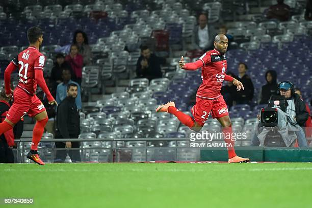 Guingamp's captain Jimmy Briand celebrates after scoring during the French L1 football match Toulouse against Guingamp on September 17 2016 at the...