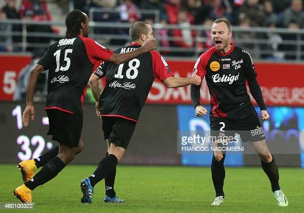 Guingamp's Danish defender Lars Jacobsen celebrates after scoring a goal during the French L1 football match Stade de Reims vs Guingamp at Auguste...