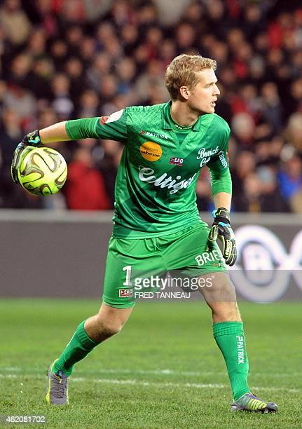 Guingamp's Danish goalkeeper Jonas Lossl grabs the ball during the French L1 football match Guingamp vs Lorient on January 24 2015 at the Roudourou...