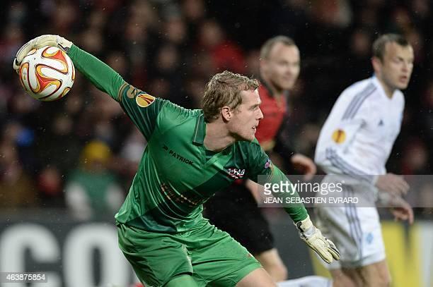 Guingamp's Danish goalkeeper Jonas Lossl throws the ball during the UEFA Europa league round of 32 first leg football match Guingamp vs Dynamo Kiev...