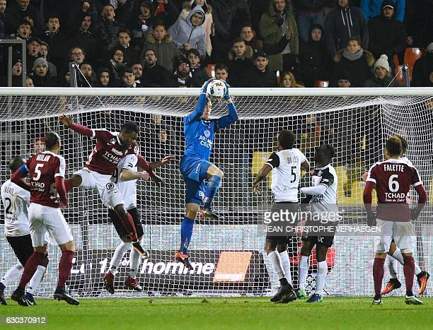 Guingamp's Danish goalkeeper KarlJohan Johnsson catches the ball during the French L1 football match between Metz and Guingamp on December 21 at the...