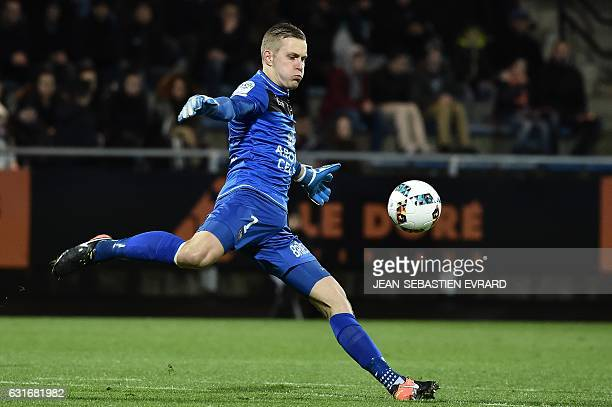 Guingamp's Danish goalkeeper KarlJohan Johnsson kicks the ball during the French L1 football match between Lorient and Guingamp on January 14 2017 at...