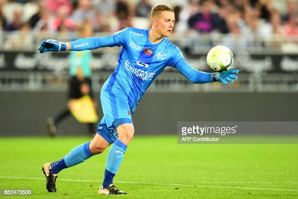 Guingamp's Danish goalkeeper KarlJohan Johnsson kicks the ball during the French L1 football match between Bordeaux and Guingamp on September 23 2017...