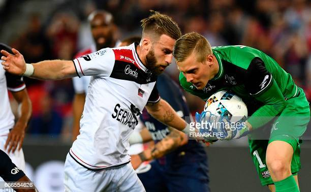 Guingamp's Danish goalkeeper KarlJohan Johnsson stops the ball during the French L1 football match between Paris SaintGermain and Guingamp at the...