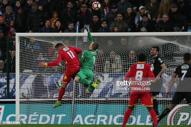 Guingamp's Danish goalkeeper KarlJohan Johnsson throws the ball clear during the French Cup football match between Quevilly Rouen and Guingamp on...